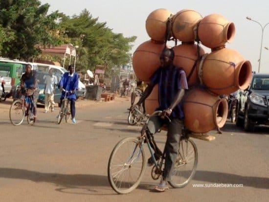 Man balancing barrels on a bike improving cross cultural skills