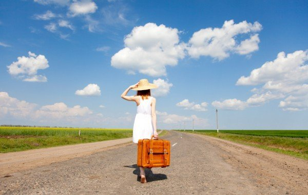 trailing spouse with suitcase in expatriate lifestyle